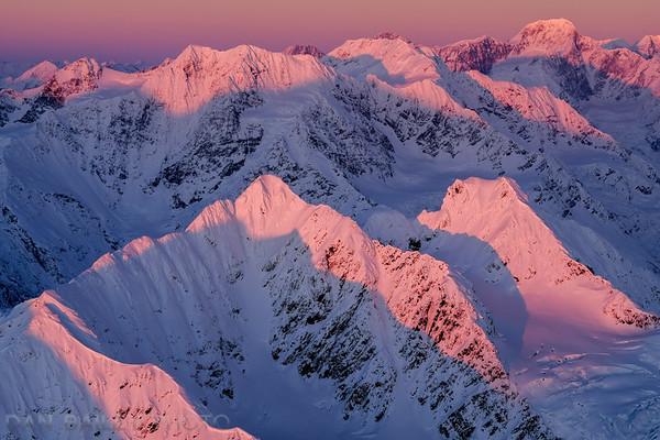 Peak 5541 and surrounding peaks of the Chugach Mountains at sunset, Alaska