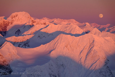 Mt. Gilbert and a full moon over the Chugach Mountains, winter, Alaska