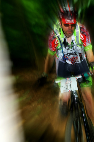 Andy DiMichelle flashes through an opening between the trees during the 12 hours of Granogue, 2012