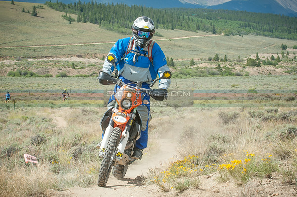 This is Earl, one of the favotite moto refs in the Rockies, and always the lead bike most of the Leadville 100 MTB.  Thank your officiaals and moto refs for all the long hard days making your race safe.  © Dejan Smaic | sportifimages.com 2014