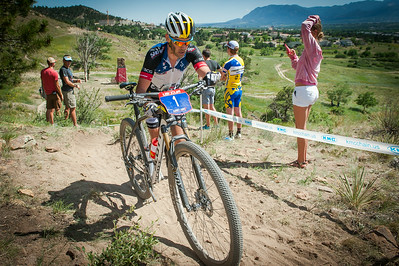 Geoff Kabush (Scott) hikes his bike during the opening laps of the mens Pro XC race.