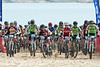 Freshmen boys division 1 field of 63 riders starts off in deep sand