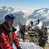 Paul on the summit. View to SE Rimpfisch-, Strahlhorn, Monte Rosa