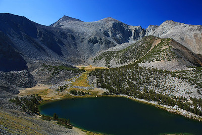 I took this photo neer the top of the rise to the plateau.  It shows Green Lake with Vagabond Peak in the distance.