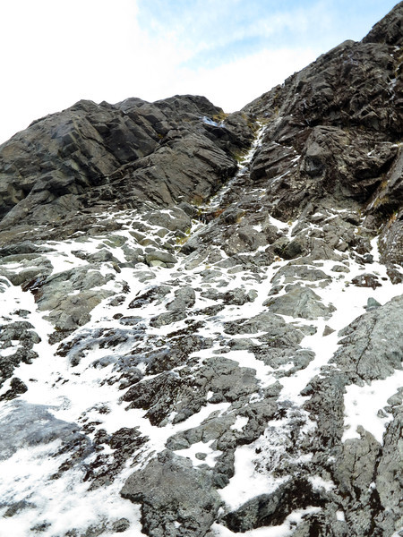 Looking up the gully that forms pitch one