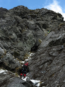 Al climbing up to the cave on pitch three, Ruari on belay. Sadly Al was insufficiently tall to pull up out of the cave (in fact, he sustained a hernia trying) but has proper Scottish ethics, refusing aid and instead leaving Ruari and me to complete the route.