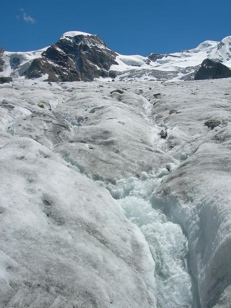 glacier river on the Vadret Pers glacier