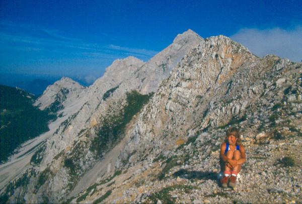 Saskia on the Bielschitza Sattel 1840m. and in the background the Hochstuhl 2236m. (Ascent Hochstuhl 2236m. (VRH Stol) Julian Alps, Yougoslavia 1987)