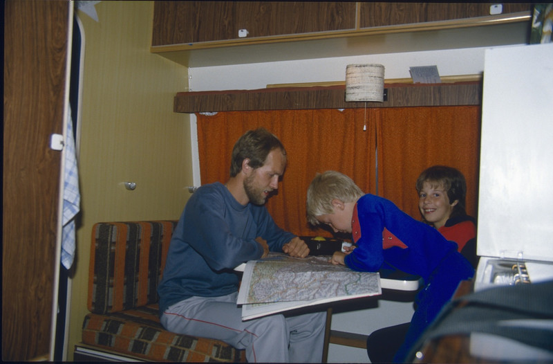 9 Aug. route preparation in the caravan with the map (Karawanken Austria 1987)