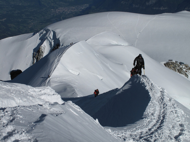 Ascending and descending Bosses arete, Mont Blanc 4810m in background Refuge Vallot 4362m