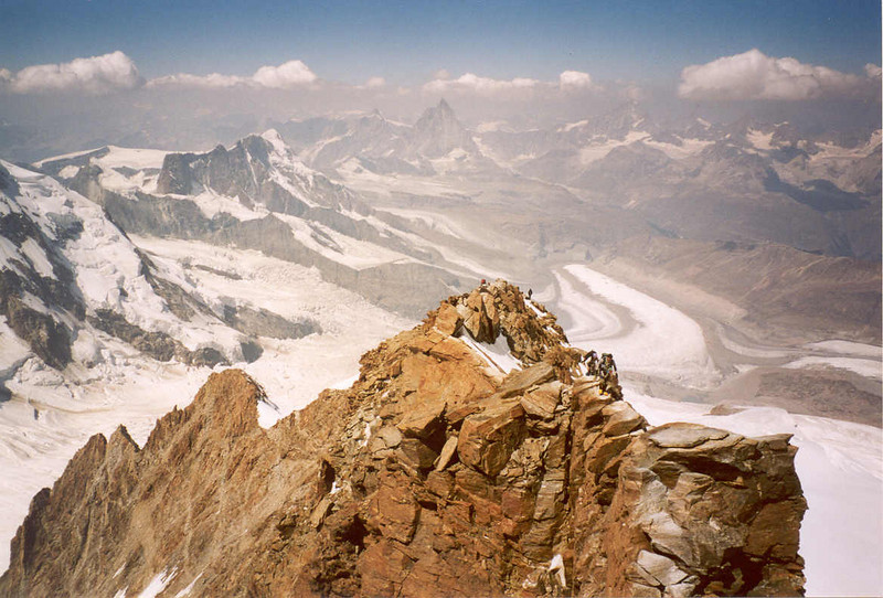 view from the summit to the subsummit Dufourspitze 4499m. (Wallis,  2003)