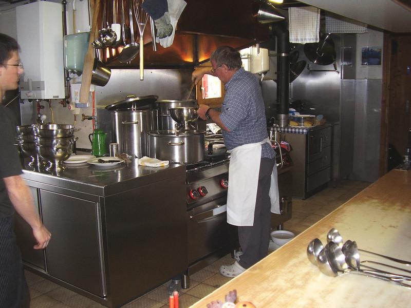 """""""Wirt"""" working in the kitchen (Cabane des Dix 2928m.)"""