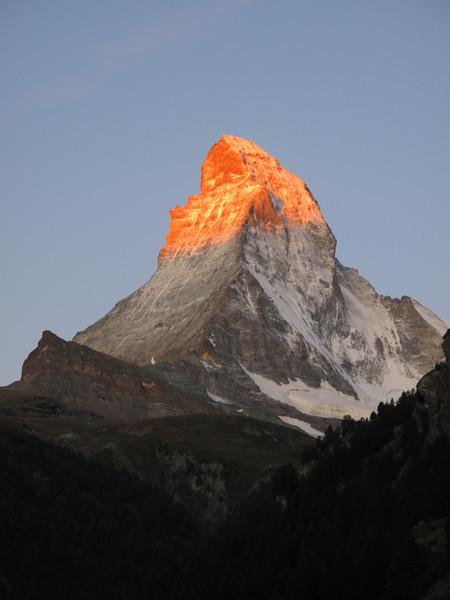 the first sunlight on the Matterhorn (Zermatt, 1672m. Wallis 2009 Switzerland                                )
