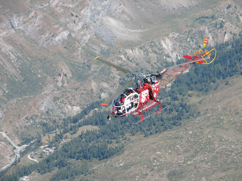 Rescue helicopter of Air Zermatt to rescue Paul ( Matterhorn 4478m. Wallis 2009, Switzerland )