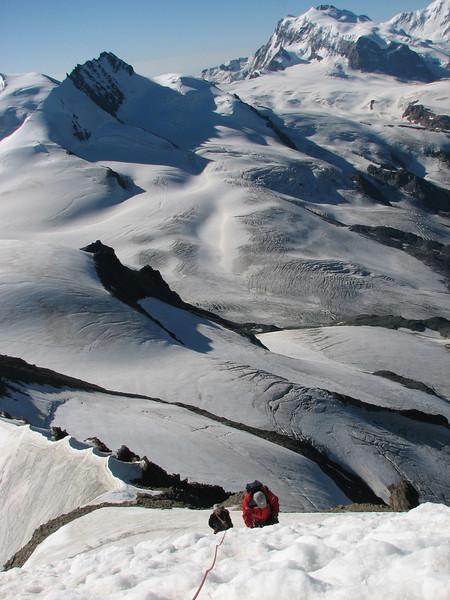 Steep climb on the nase of the Alphubel background: Rimpfischhorn and Monte Rosa (Alphubel, 4206m. Wallis 2009 Switzerland)