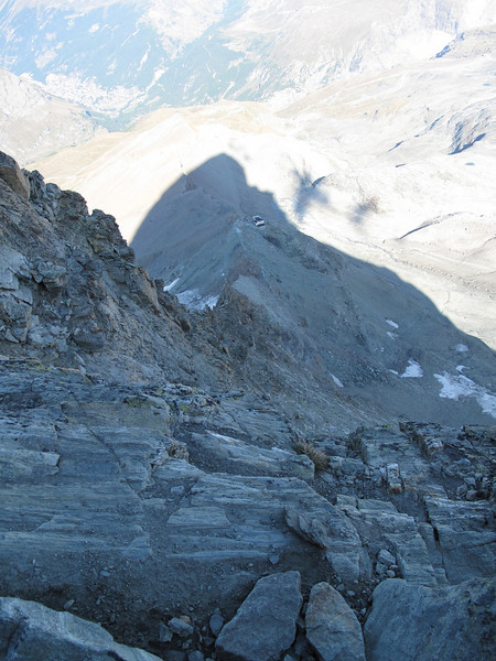 view down from the Salvoy Hut with the shadow of the Matterhorn (Matterhorn 4478m. Wallis 2009, Switzerland)