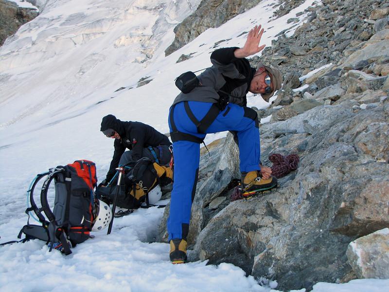 mounting crampons near Cabane de la Dent Blanche CAS 3507m