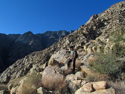As you can see, there is no trail and it is a rocky fairly steep ascent.  The ridge line in the distance is our goal.