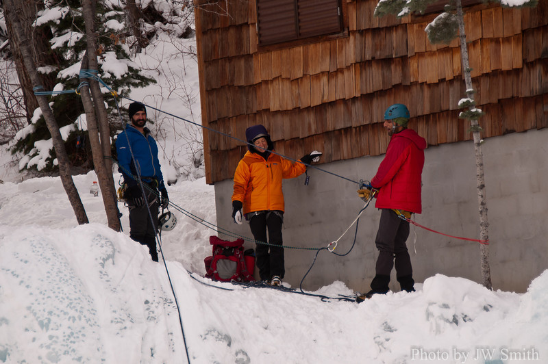 Ouray 2012-40 - Jason and Leah try to distract Saif as he belay's John on Whitt's World. This anchor is below the Ice Park office (Dick's Chalet)