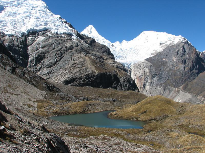 Lake Cullicocha 4628m. and the first view of the W side of the Alpamayo 5947m. (Peru 2009, Lake Cullicocha 4628m. - Calamina 3950m. Cordillera Blanca)