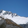 Spot the parachuter right of French Ridge Hut, at the same height as the top of Mt Avalanche