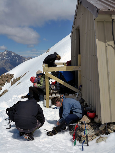 Packing up after lunch at Alpine Rec's Caroline Hut