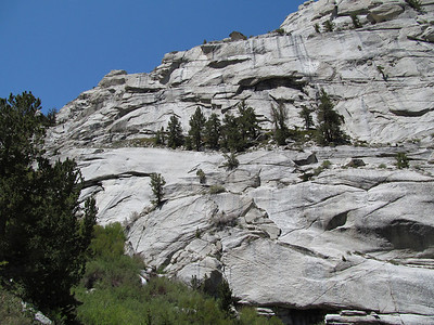 Another view of the ledges showing the route from the trees that proceeds up to the left to Lower Boy Scout Lake.