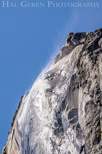 The wind takes the steam rising from melting snow on the cliff face. El Capitan Yosemite, California 1204Y-ECW1