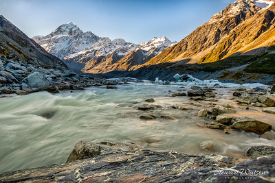 Long exposure of the Alpine river flowing out of the Hooker valley lake in the Aoraki Mount Cook National Park