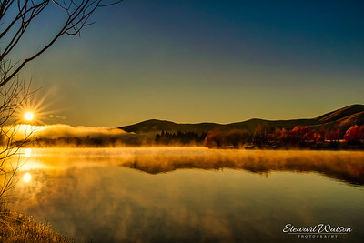 Wairepo Arm Lake Ruataniwha at sunrise in the mist