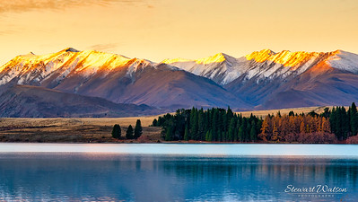 The last sun of the day catching the mountain peaks at Lake Tekapo