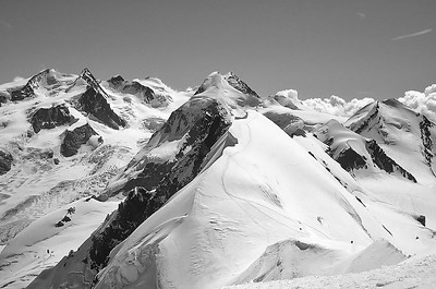 View over Lyskamm and Monte Rosa from the Breithorn ridge, Italy