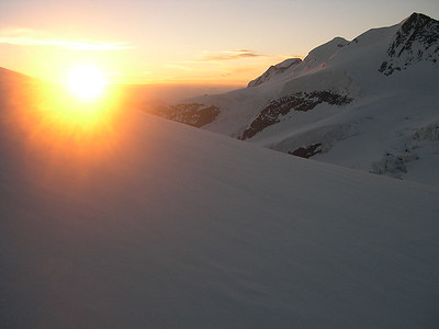 Sunrise behind the final ridge of Piz Bernina (4.049m), Switzerland