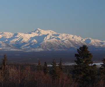 2/19/07 - Noyes Mt rises above the lesser peaks and the Suslota Valley far across the frozen Copper River.