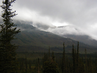 7/30/04 - Early morning fog laying in the mountains just north of Coldfoot.  Around MP 180.