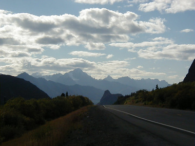 The Talkeetna Mts. to the right (north) of the highway, the Chugach Mts. ahead and out of sight to the left (south) with Lion's Head Butte jutting up from the Matanuska Valley between the two mountain ranges.