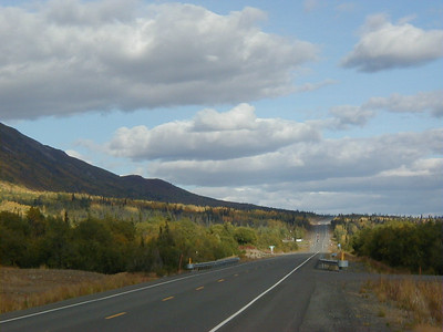 The Glenn Hwy. near Sheep Mt. Lodge; the slope of Sheep Mt. (part of the Talkeetna Mts.) on the left.