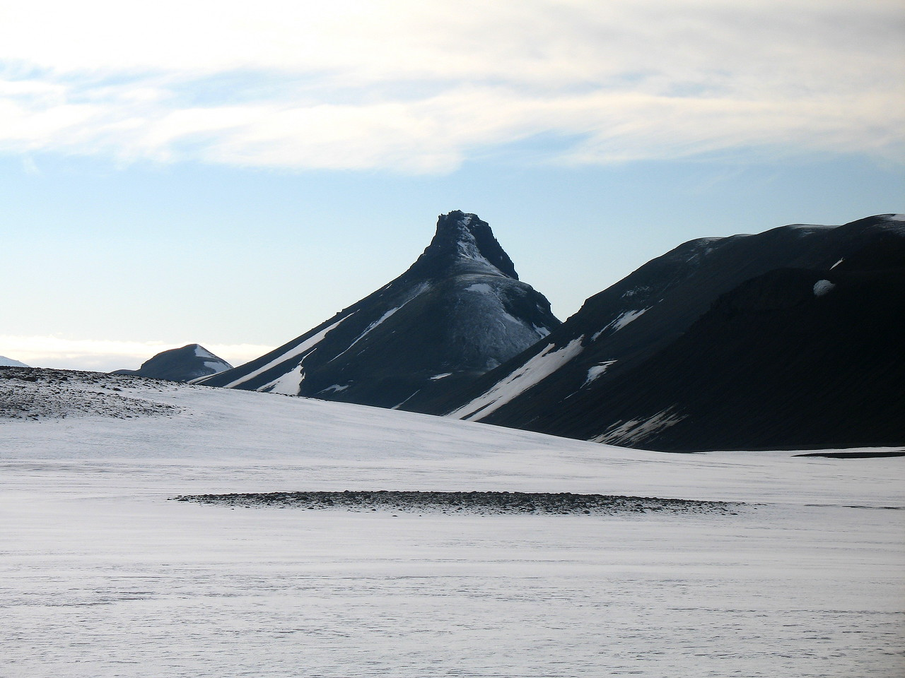 """View from the NNE, an """"end-on"""" view. This is the ascent route recommended in the book """"Icelandic Mountains, Hiking Routes to 151 Peaks"""" but we didn't fancy our chances on those icy rock outcrops near the top!"""