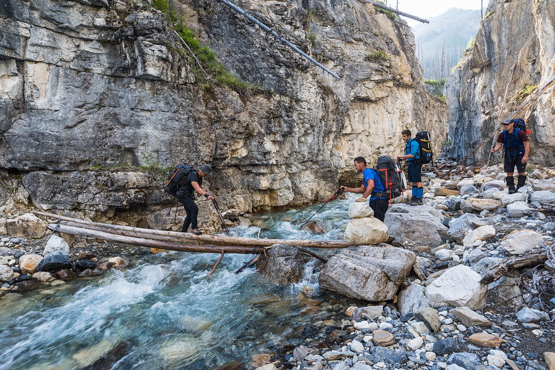 Leon crossing the creek. The logs were chained down to the rocks on each end and we were optimistic that the permanent structure ment we were on the right track.