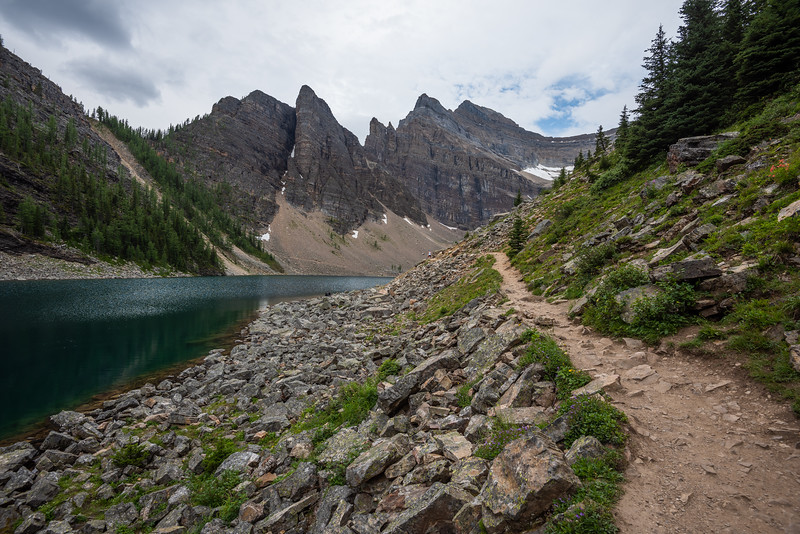 Lake Agnes trail, devils thumb, and Mt Whyte in the back. The col we're aiming for is on the skyline right.