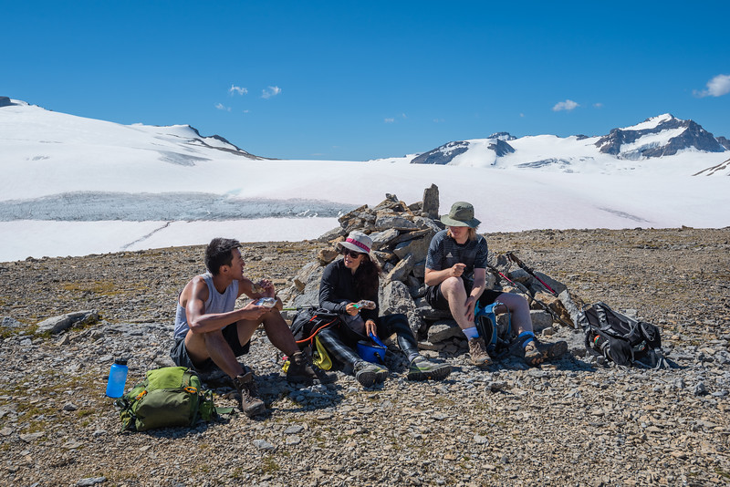 Conor, Goga and Changchi on the summit of the Onion having some snacks.