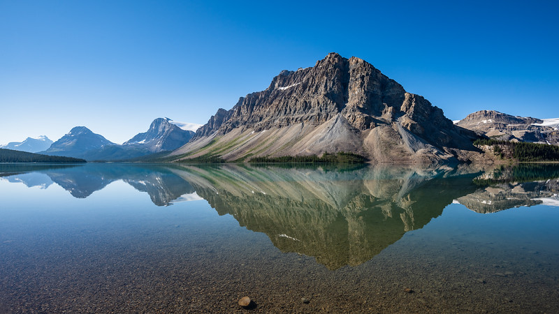 Bow lake and it's morning reflections. We're walking around the lake heading towards the back.