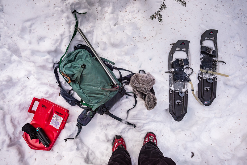 Changing gear from microspikes to snow shoes.