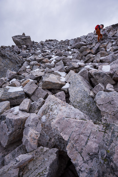Conor making his way over the large talus.