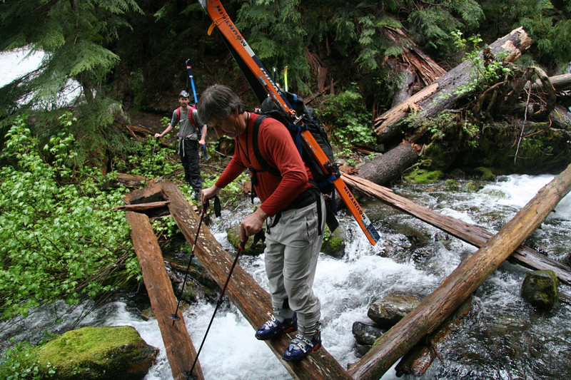 "Russ demonstrates the approved ""poles downstream, skier upstream, little-bitty-side-steps"" approach to the ""bridge"" crossing."