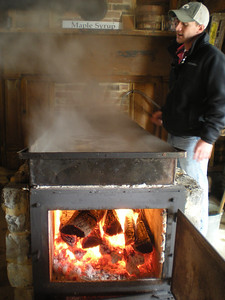 The sugar water is boiled over a wood fire.