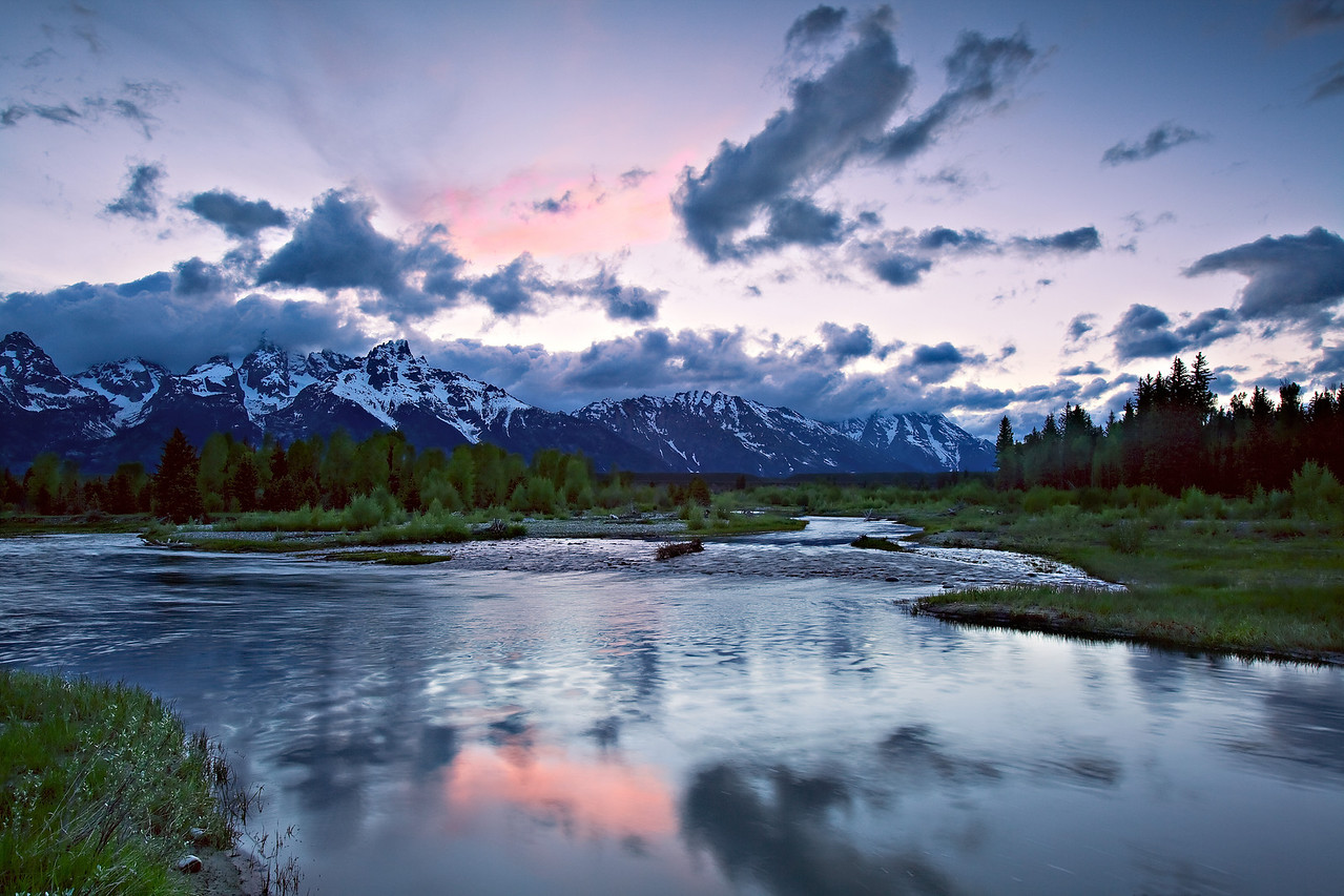 Pink Tetons - A dab of pink highlights the sky over the Grand Teton mountains, Tetons National Park.