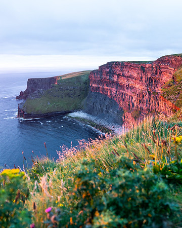 The Cliffs of Moher and a sunset glow, on a late summer afternoon in Ireland.