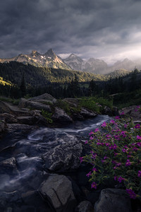 Light breaks through clouds after a storm, lighting up the Tatoosh Range, Washington