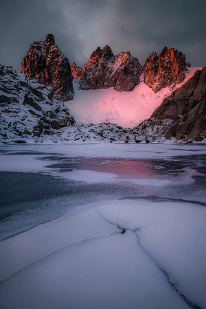 Three towers light up from an epic sunrise glow - The Enchantments, Washington